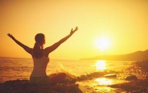 39653068 - yoga at sunset on the beach. woman doing yoga, performing asanas and enjoying life on the sea